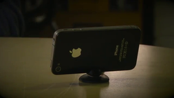 "A tiltable iPhone 4/4S micro ""tripod"" stand that fits in your pocket"